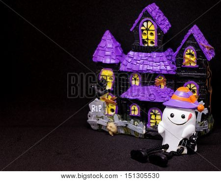 Halloween White Ghost with purple house copy space