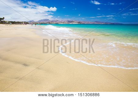 View to Costa Calma sandy beach with vulcanic mountains in the background on Fuerteventura island Canary Islands Spain.