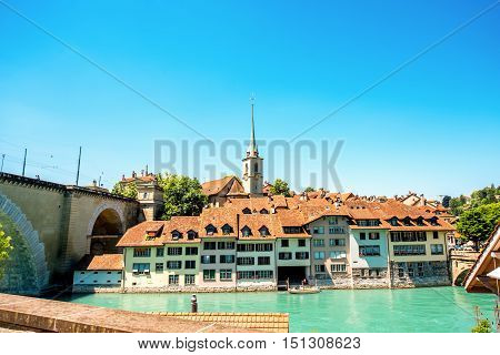 Cityscape view on the old town with Nydegg church tower and the river in Bern city in Switzerland