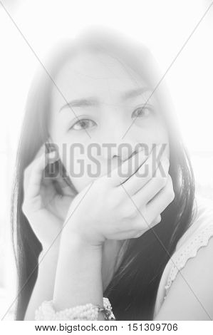 portrait of young asian woman looked at camera,high key picture style,black and white color picture,soft focus
