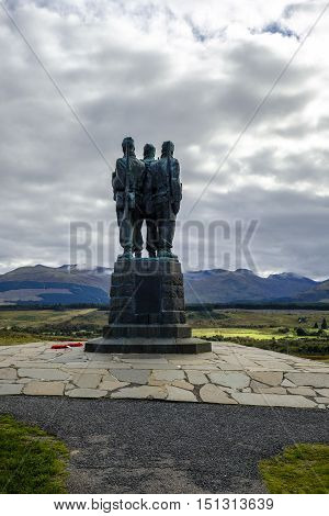 SPEAN BRIDGE SCOTLAND - 1 Oct 2016: The three uniformed servicemen of Commando Memorial admire the view of the beautiful Scottish Highalnds landscape. This cast bronze sculpture is dedicated to the British Commando Forces who trained here in WWII.
