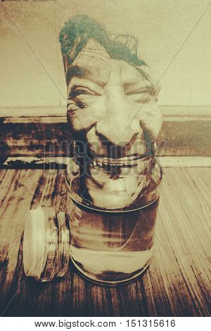 Frightening b grade horror scene of a laughing monsters head decompressing from vinegar glass. Return of old Halloween Harold