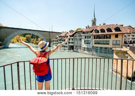 Young female tourist enjoying great view on the old town of Bern city in Switzerland. Having great vacation in Switzerland