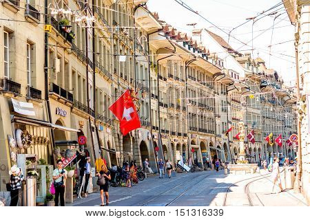 Bern, Switzerland - June 24, 2016: Street view on Kramgasse with people in the old town of Bern city. Kramgasse is a popular shopping street and medieval city centre of Bern, Switzerland.