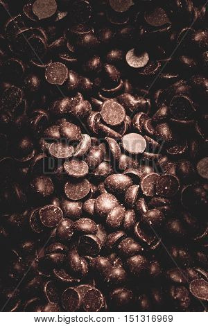 Full frame background of chocolate chips for concept about delicious baking sweeteners