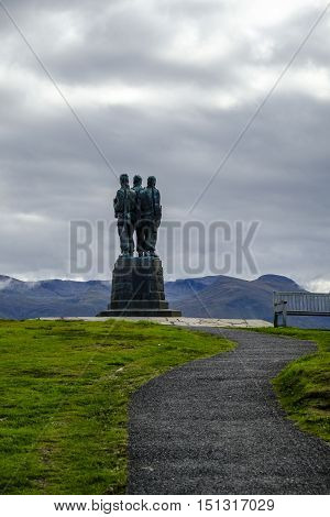 SPEAN BRIDGE SCOTLAND - 1 Oct 2016: The three uniformed servicemen of Commando Memorial appear to gaze over the beautiful Scottish Highalnds landscape. This cast bronze sculpture is dedicated to the British Commando Forces who trained here in WWII.