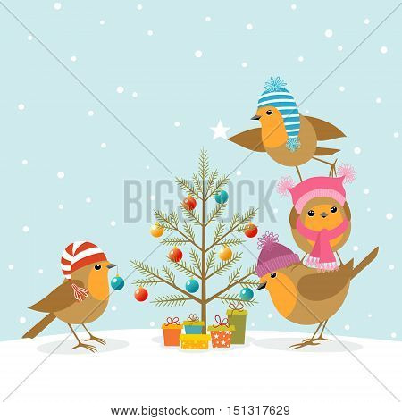 Funny cute Robins decorating a Christmas tree.