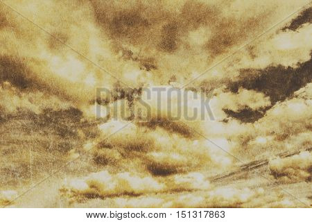 Horizontal skyscape of atmospheric grunge clouds with scratched texture. Hostile background