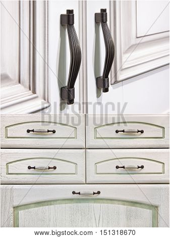 set. silver handles on white cabinet doors