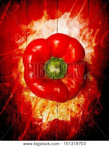 Kitchen artwork design on a Capsicum red pepper on wooden countryside board. Cooking preperations