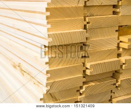 Stack of new wooden planks. Close up.