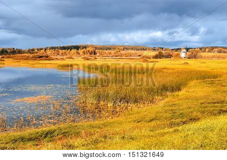 Autumn picturesque landscape of river valley in autumn sunny day. Autumn natural landscape of autumn nature in sunny autumn weather. Autumn colorful valley landscape- autumn landscape in golden colors