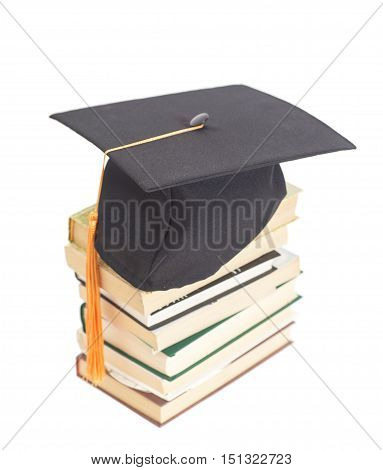 Graduation Hat with books isolated on white