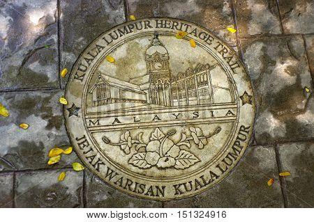 KUALA LUMPUR MALAYSIA - JANUARY 16 2016: a round memorial pate on ground - symbol of the city.