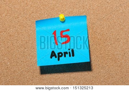 April 15th. Day 15 of month, calendar on cork notice board, business background. Spring time, empty space for text.