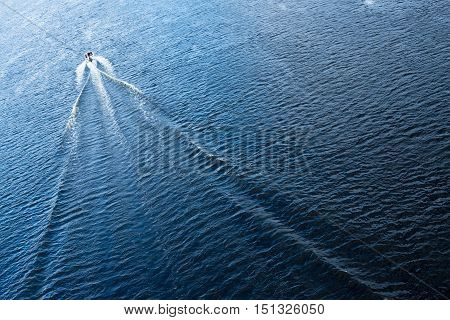 The motor boat floating in the blue Dnieper waters.