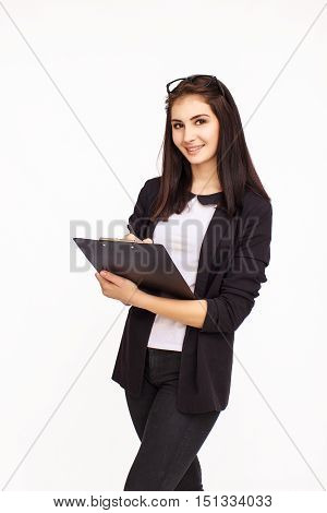 Young happy businesswoman writing something in tablet