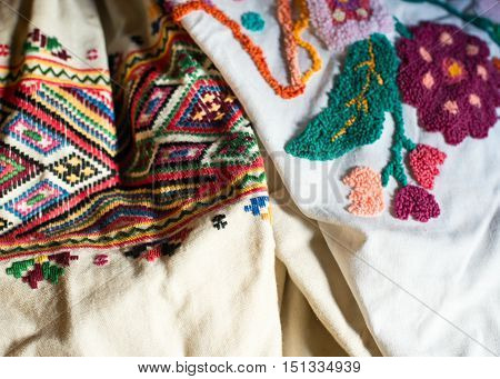 Women's dresses with traditional Ukrainian embroidery. Close up.