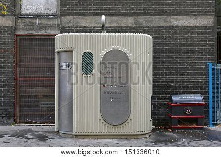 LONDON UNITED KINGDOM - NOVEMBER 24: Automated Public Toilet in London on NOVEMBER 24 2013. Public Restroom Cabin With Automatic Cleaning in City of London United Kingdom.