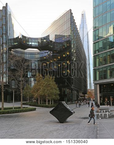 LONDON UNITED KINGDOM - NOVEMBER 23: New Development at London Riverside on NOVEMBER 23 2013. More London Riverside and The Shard at Southwark in London United Kingdom.