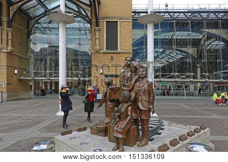 LONDON UNITED KINGDOM - NOVEMBER 24: The Kindertransport Statue at Front of Liverpool Street Station in London on NOVEMBER 24 2013. Children Transport Monument by Artists Frank Meisler and Arie Oviada at Liverpool Station in London United Kingdom.