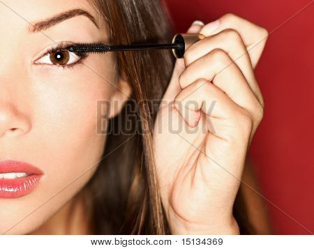 Woman Putting Mascara Makeup