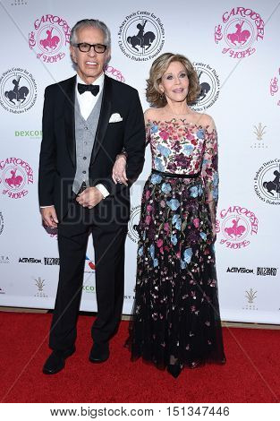 LOS ANGELES - OCT 8:  Jane Fonda and Richard Perry arrives to the Carousel of Hope 2016 on October 8, 2016 in Hollywood, CA