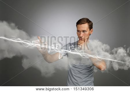 Man making magic effect - flash lightning. The concept of electricity, high energy.