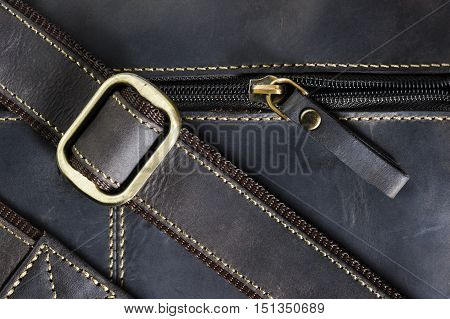 Leather bag with zipper, shoulder strap and stitches, men's accessories, macro shot, selective focus