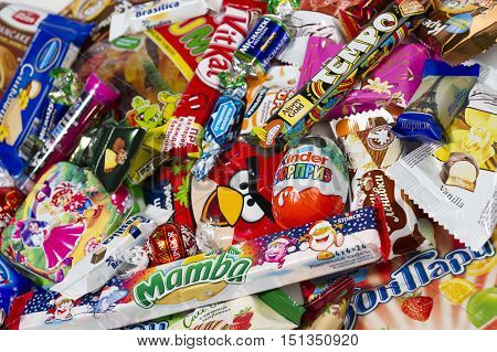 Moscow, Russia - January 02, 2016: Kinder Surprise, Angry Birds, Lindor, Kit Kat, Tempo, Mamba, Haribo Wummis, Brasilica, Michaszki and many other candies, chocolates and sweets for kids manufactured by different companies. Selective focus. Studio shot.