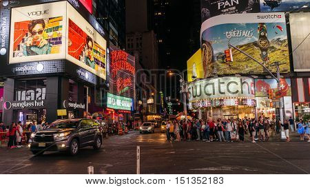New York USA - September 20 2015: People and illuminated billboards at Times Square in Midtown Manhattan at night.