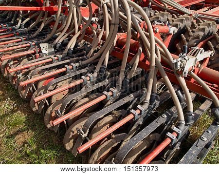 Modern agricultural machinery seeding machine hooked to a big tractor