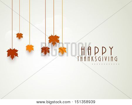 Happy Thanksgiving Day celebrations greeting card design with hanging maple leaves on grey background.