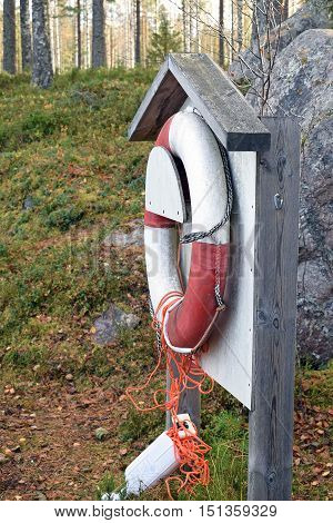 Old life buoy hanging on the beach.