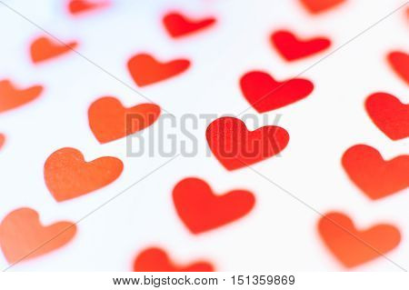 Single Red Heart In Focus Between Many Others