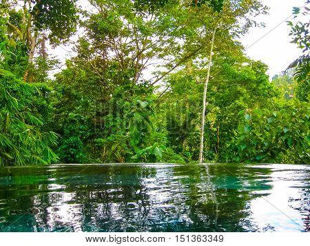 Bali Indonesia - April 13 2014: View of swimming pool at Nandini Bali Jungle Resort and Spa.