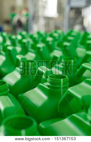 Empty Plastic Cans Green Color.