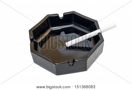 cigarette in the ashtray on a white background