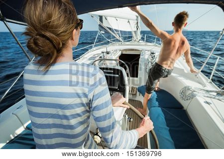 Young couple sailing in Andaman sea at sunny day