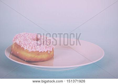 Iced Doughnut On A Light Blue Background Vintage Retro Filter.