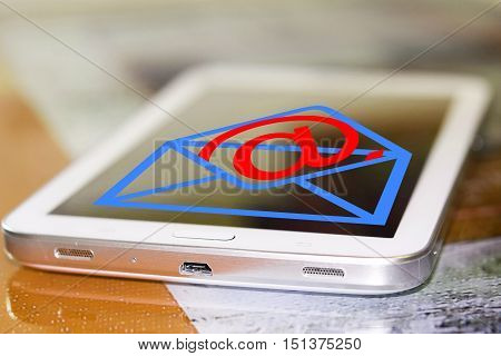 Email symbol on screen of cell phone . The concept of online correspondence .