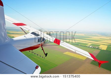 The plane sprays farmers' fields, the plane flies over the ground, aviation in agriculture