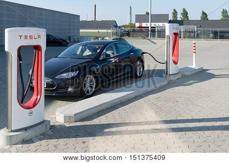Aarhus, Denmark - September 14, 2016: Tesla Car Being Charged At Supercharger