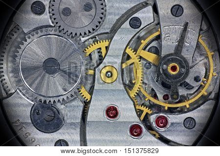 Old soviet pocket watch inside mechanism with wheels springs and rubies