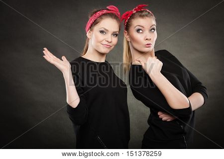 Good humor concept. Retro style and old fashion. Two smiling happy girls in red handkerchief. Women styled on pin up vintage.