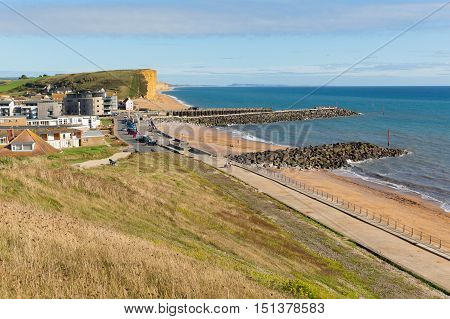 West Bay Dorset uk view towards the east of the Jurassic coast on a beautiful summer day with blue sky and sea