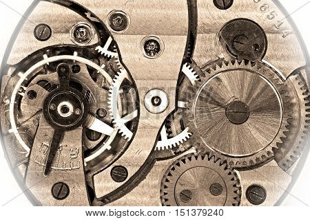 Old soviet pocket watch mechanism in sepia with white vignette
