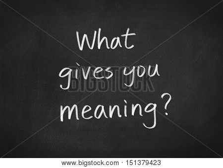 What gives you meaning text on blackboard background