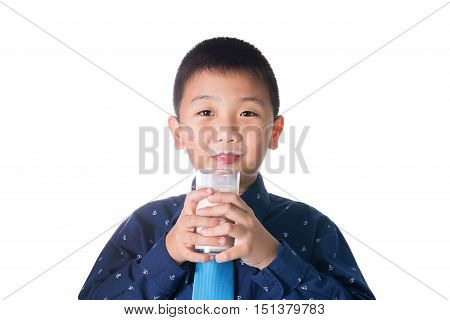 Boy drinking milk with milk mustache holding glass of milk isolated on white background.