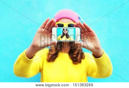 Fashion Cool Girl Taking Photo Self Portrait On Smartphone Over White Background Wearing A Colorful